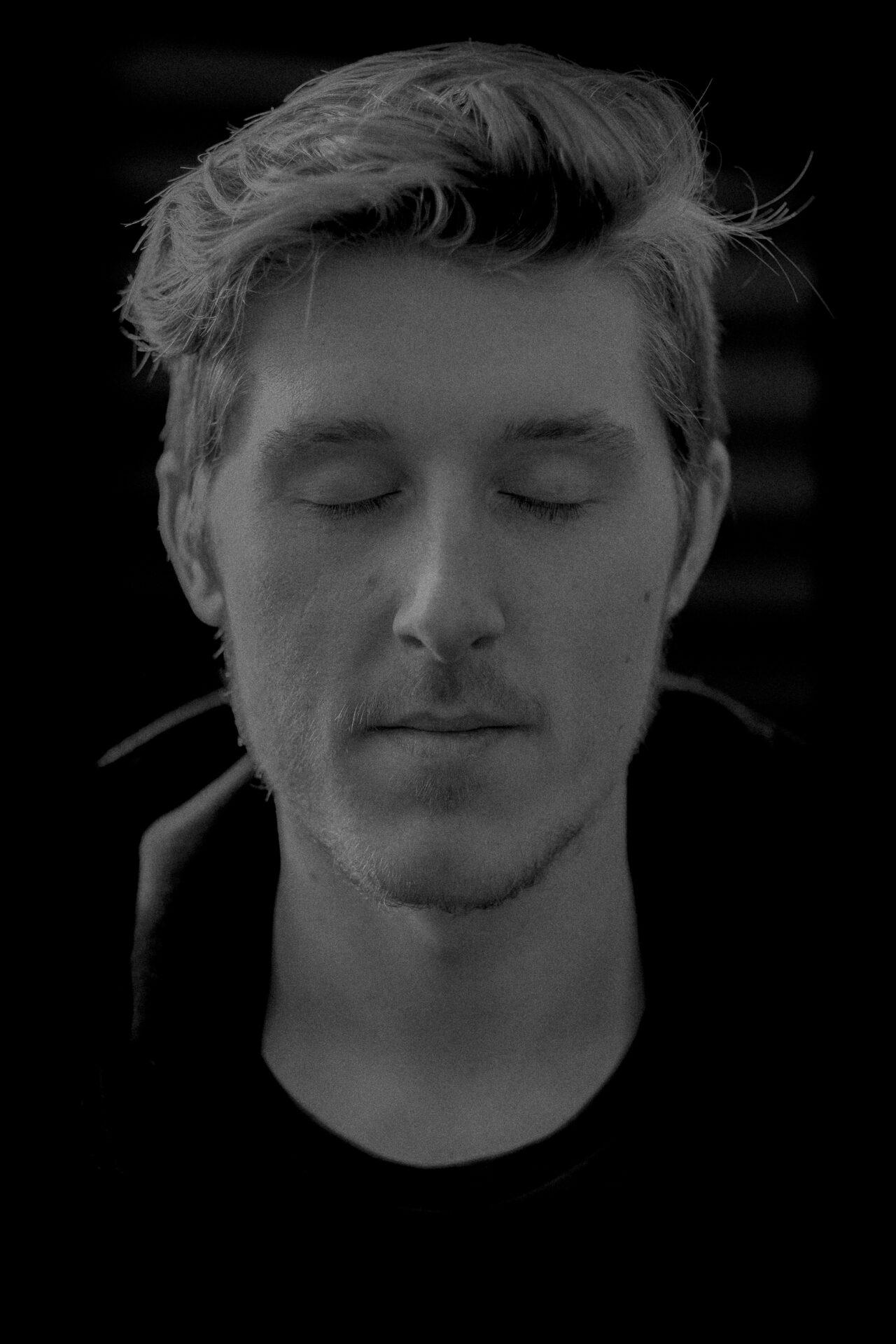 male portrait closed eyes